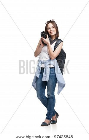 Young woman tourist with camera and backpack