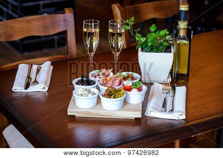 Italian Aperitif From A Variety Of Snacks On A Table For Date