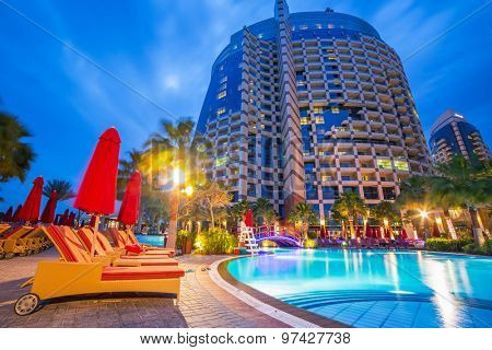 ABU DHABI, UAE -25 MARCH 2014: Pool area of resort Khalidiya Palace by Rotana, United Arab Emirates. Rotana Hotel Management Corporation has 85 properties in 26 cities around Middle East and Africa.