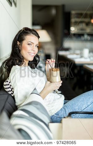 Gorgeous Lady Sipping Coffee In A Bar In A Leisurly Posture
