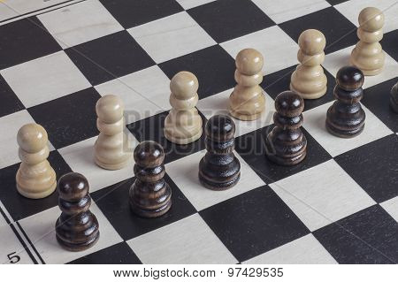 Chess Game Concept With Chess Pawns And Wooden Chess Board.