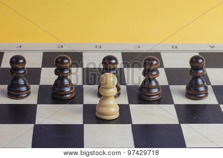 Wooden Chess Pawns On Chess Board.