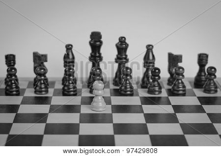 Chess Set With One Chess Pawn In Front. Black And White Photo.