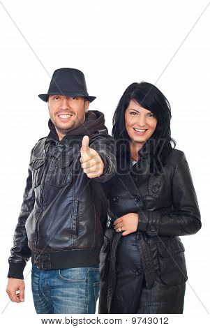 Laughing Couple In Leather Give Thumbs