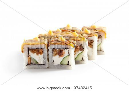 Maki Sushi - Roll with Fried Salmon, Cucumber and Cheese inside. Topped with Omelette