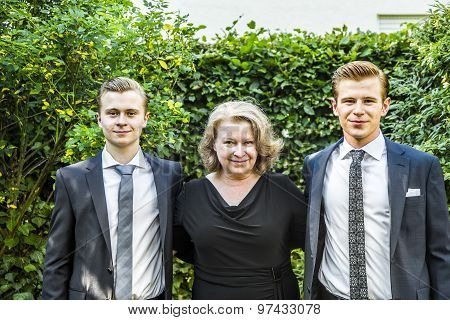 Portrait Of Mother With Her Two Adolescent Sons