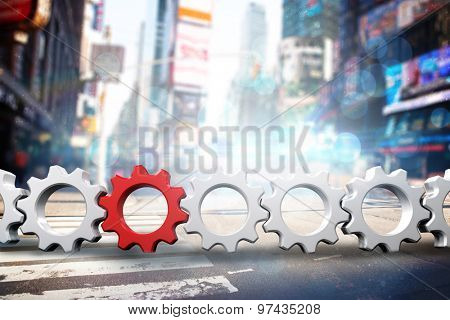 Red and white cogs and wheels against blurry new york street