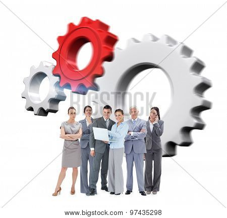 Business team looking at camera against white and red cogs and wheels