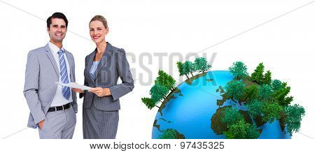 Business people looking at camera against earth with forest