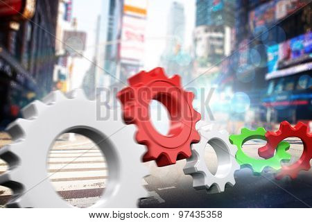 White and red cogs and wheels against blurry new york street