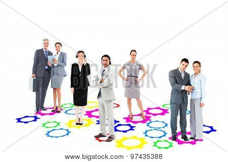 Business team against cog and wheel floor