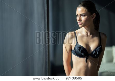 Young, Beautiful Woman In Lingerie Looking Staring Through Hotel Room Curtains