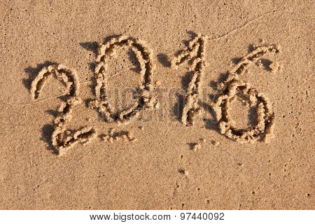 New Year 2016 Written In The Sand In The Morning Sun