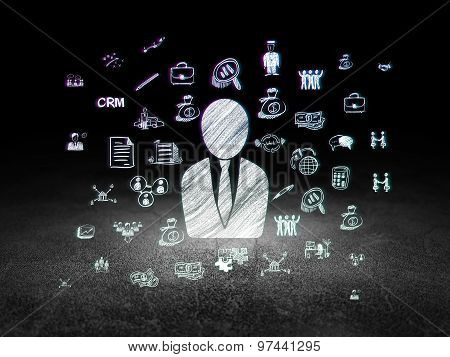 Business concept: Business Man in grunge dark room