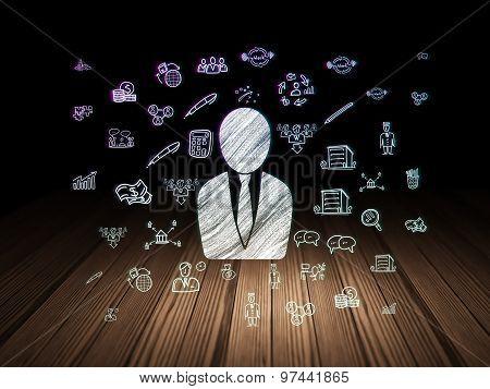Business concept: Business Man in grunge dark room