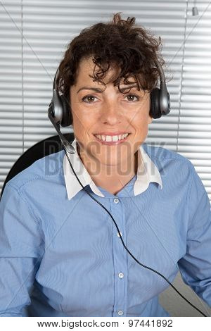 Smiling And Happy Woman With Headphone At Office