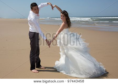 Beautiful Couple At The Beach Happy Together