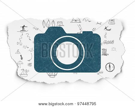 Tourism concept: Photo Camera on Torn Paper background