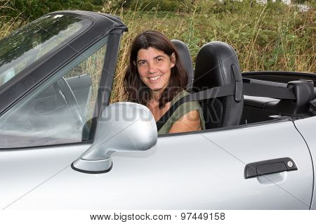 Brunette Woman Sat In A Convertible Sports Car