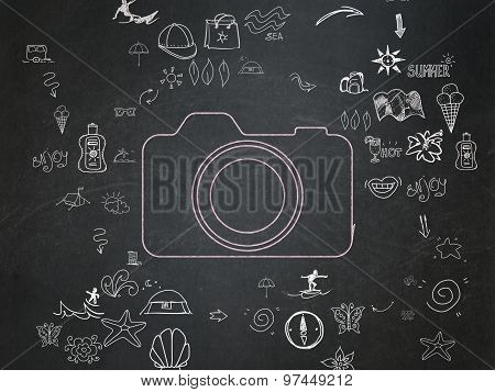 Travel concept: Photo Camera on School Board background