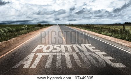 Positive Attitude written on rural road