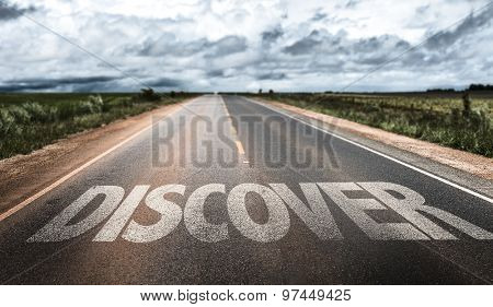 Discover written on rural road