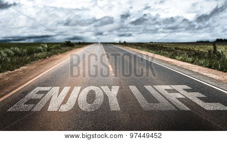 Enjoy Life written on rural road