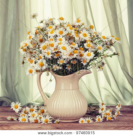 Bouquet Of Chamomile In A Vase On The Old Boards. Retro Hipster Version