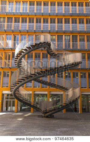 MUNICH, GERMANY - JULY 30, 2015: Rewriting stairs sculpture in form of a double helix with infinite stairs, a 9 meter high sculpture designed by Olafur Eliasson in 2004 and it is located in the courtyard of the KPMG office building