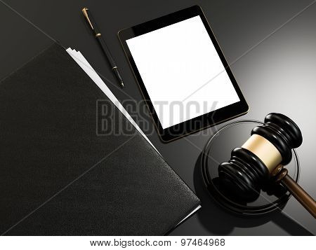 Wooden Judges Gavel And  Tablet Computer On Black Table