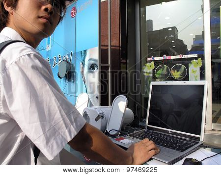 Man Try Laptop At Outside Display At Store