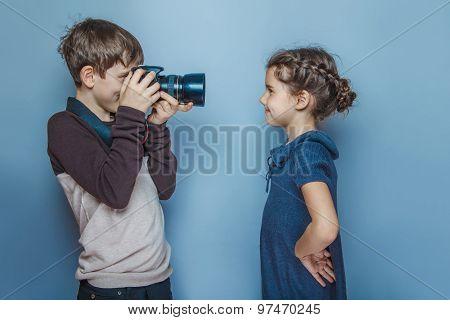 Boy teenager  European appearance  photographs teen  girl on a g