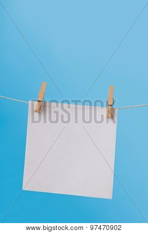 Single Note Paper On Washing Line Against Blue Sky