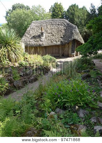 Rural Pathway Leading To Thatched Summerhouse