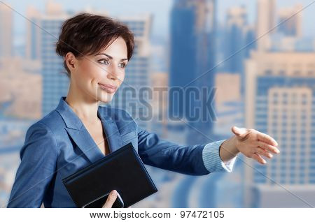 Confident business woman pulls her hand for a handshake, executive manager on negotiations, making great deal, lifestyle of successful people