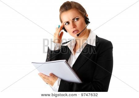 worried modern business woman with headset and notebook