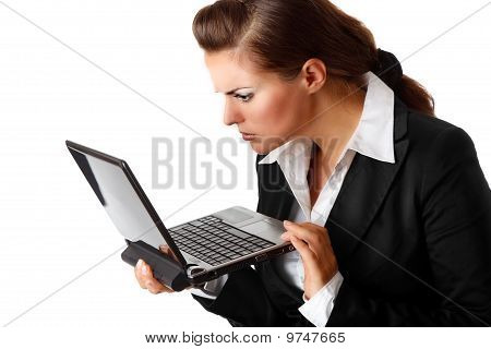 modern business woman amazedly looks in laptops screen