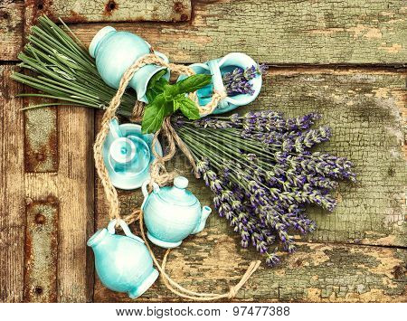 Lavender Flowers Over Rustic Wooden Background. Shabby Chic