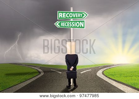 Entrepreneur Look At Signboard With Recovery Recession Words
