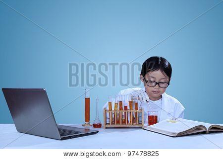 Little Asian Scientist Doing Experiment