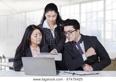 Manager Showing Business Plan At Team