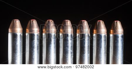Handgun Cartridges With Red Tipped Bullets