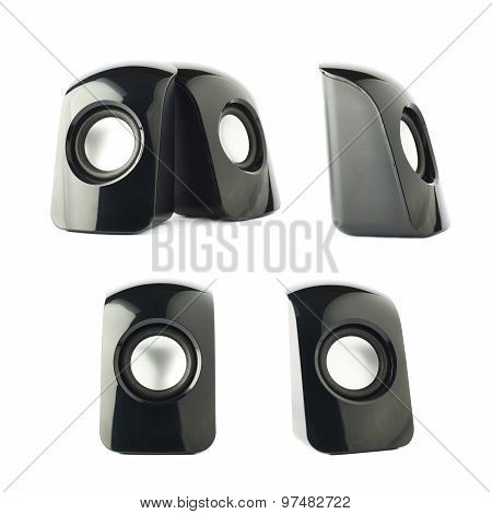 Black glossy plastic sound speakers isolated