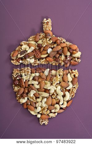Nuts In Shape Of Acorn Concept.
