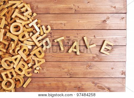 Word tale made with wooden letters