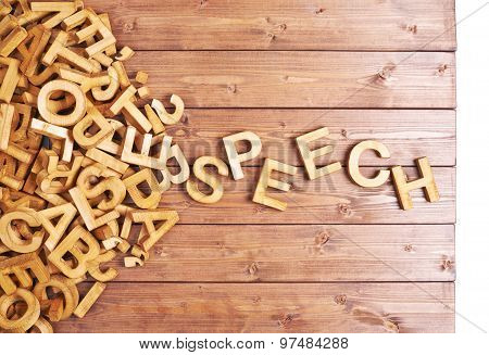 Word speech made with wooden letters
