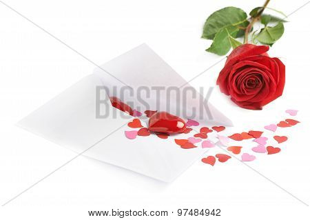 Rose and envelope filled with hearts