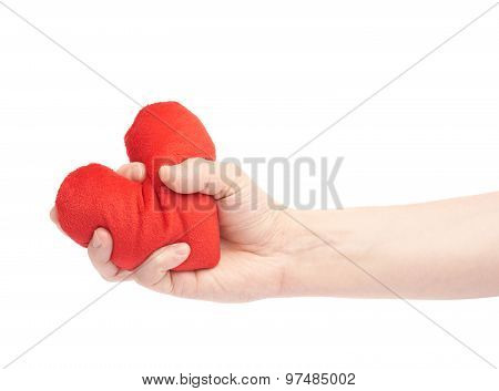 Squeezing a red heart with a hand