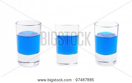 Small glass shot filled with liqueur isolated