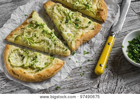 Pizza With Zucchini, Onion, Cheese And Sesame Seeds On A Light Wooden Background